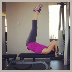 Keep your spine is neutral against the bench as you lower your legs!